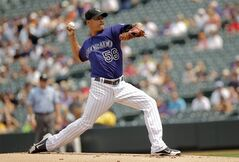 Pitcher Guillermo Moscoso works out on Aug. 15, 2012, in Denver. The Toronto Blue Jays claimed right-hander Guillermo Moscoso off waivers from the Kansas City Royals on Saturday. THE CANADIAN PRESS/AP, Barry Gutierrez