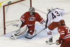 Columbus Blue Jackets' Sean Collins (43) scores the game winning goal against Carolina Hurricanes goalie Cam Ward (30) during the third period of an NHL preseason hockey game in Raleigh, N.C., Wednesday, Sept. 18, 2013. (AP Photo/Gerry Broome)