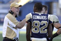 Winnipeg Blue Bombers'  head coach Paul LaPolice talks to Terrence Edwards (82) during a recent game. Lapolice fended off questions whether the team's poor performance meant his job was on the line.
