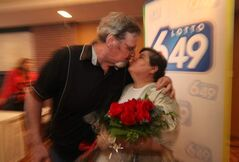 Bruce and Monique Willman embrace at Wednesday's news conference, which was packed with family and friends.