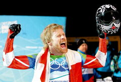 Manitoba's Jon Montgomery celebrates winning the gold medal in men's skeleton Friday night at the Whistler Sliding Centre.