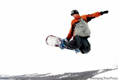 Snowboarder gets some air at Asessippi.