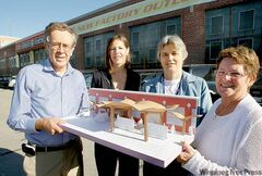From left, Dudley Thompson, principal architect with Prairie Architects Inc., with a model of the new front for the building, with Cindy Rodych, vice-president Stantec Architecture, Cheryl Susinski, executive director, Rehabilitation Centre for Children, and Jeanette Edwards, WRHA regional director of primary health care.