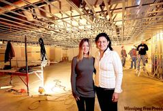 Yoga Public's Samantha Chisick (left) and Ida Albo at the downtown facility under construction.