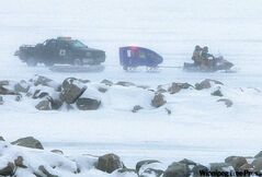 Emergency crews gather at Balsam Bay Harbour to search for men whose truck fell through the ice on Lake Winnipeg.