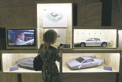 A visitor takes picture of models of James Bond�s Lotus Esprit.