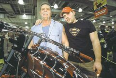 Paul Teutul, shown with son Paul Jr., has placed his merchandising unit into bankruptcy.