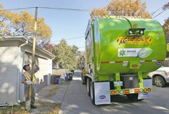 Joe Bryksa / Winnipeg Free Press archives Some lines in back lanes are too low for Emterra's garbage and recycling trucks.