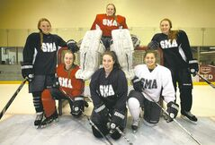 The six Grade 12 members of the St Mary's Academy Flames: (bottom row from left) Kathyrn Moss, Jenna Thompson, Kelly Matarazzo; (top row from left) Riann Ritchot, Annie Chipman, Christine Bumstead. St. Mary's is hosting the tournament at the MTS Iceplex.