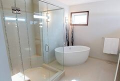 The ensuite's heated (beige) tile floor, free-standing soaker tub, custom tile shower with seamless glass doors and dual sinks on granite over top of an espresso thermofoil vanity combine to create an ambience that invites you to exhale the day's tensions.