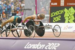 Canada's Colin Mathieson, right, races during a men's 100m T54 round 1 race at the 2012 Paralympics in London, Saturday, Sept. 1, 2012.