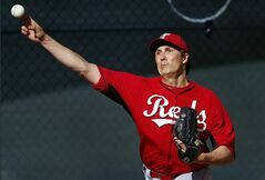 Cincinnati Reds pitcher Homer Bailey throws during spring training baseball practice in Goodyear, Ariz., Saturday, Feb. 15, 2014. (AP Photo/Paul Sancya)