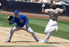 Chicago Cubs' Cameron Maybin, right, beats the throw to first as Cubs first baseman Anthony Rizzo, left, awaits the throw in the fifth inning of a baseball game Sunday, May 25, 2014, in San Diego. Maybin was later picked off of first. (AP Photo/U-T San Diego, Sean M. Haffey)