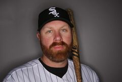FILE - In this Saturday, Feb. 22, 2014 file photo, Chicago White Sox Adam Dunn poses for his photograph during baseball spring training photo day in Glendale, Ariz. Dunn on Thursday, Feb 27, 2014 said he'll be attending this year's Academy Awards with the contingent from the Matthew McConaughey film