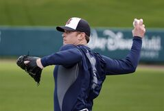 Atlanta Braves pitcher Gavin Floyd throws during a spring training baseball workout in Kissimmee, Fla., on Feb. 13, 2014. The Atlanta Braves have activated right-hander Gavin Floyd from the disabled list and optioned left-handed reliever Ian Thomas to Triple-A Gwinnett. THE CANADIAN PRESS/AP, Alex Brandon