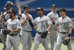 Chicago White Sox, from left to right, Tyler Flowers, Leury Garcia, Paul Konerko, Moises Sierra, Jake Petricka, and Gordon Beckham celebrate the White Sox's 4-0 victory over the Toronto Blue Jays during MLB baseball action in Toronto on Sunday, June 29, 2014. THE CANADIAN PRESS/Darren Calabrese