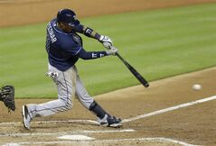 Tampa Bay Rays' Yunel Escobar (11) hits a single against the Miami Marlins in the fourth inning of an interleague baseball game in Miami, Monday, June 2, 2014. (AP Photo/Alan Diaz)