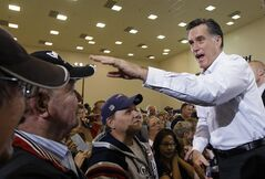 Republican presidential candidate, former Massachusetts Gov. Mitt Romney, campaigns at Astrotech Space Operations in Cape Canaveral, Fla., Friday, Jan. 27, 2012. (AP Photo/Charles Dharapak)