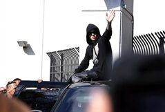 FILE - In this Jan. 23, 2014, file photo, singer Justin Bieber leaves the Turner Guilford Knight Correctional Center in Miami. A Miami-Dade County judge on Tuesday, Jan. 28 set a Feb. 14 arraignment date for the 19-year-old star on charges of DUI, resisting arrest and driving with an expired license. (AP Photo/El Nuevo Herald, Hector Gabino, File)