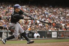 Colorado Rockies' Brandon Barnes hits a two-run inside-the-park home run off San Francisco Giants pitcher Sergio Romo during the ninth inning of a baseball game in San Francisco, Saturday, June 14, 2014. (AP Photo/Jeff Chiu)