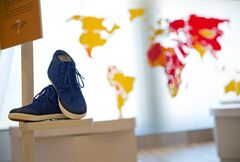 In this June 16, 2014 photo, a pair of sneakers are displayed as part of an exhibit exploring the ethical footprint of common consumer products at the newly built National Center for Civil and Human Rights in Atlanta. The new museum about the history of civil rights opens next week in Atlanta, the city where Martin Luther King Jr. was based. But the National Center for Civil and Human Rights also explores other human rights struggles, from women's rights and LGBT issues to immigration and child labor. The museum devotes separate galleries to modern human rights issues and the U.S. civil rights movement of the 1950s and '60s, but also demonstrates how the two struggles are related. Visitors learn history through interactive exhibits and stories of real people. (AP Photo/David Goldman)