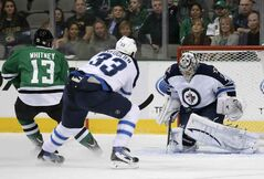 Winnipeg Jets goalie Ondrej Pavelec (right) blocks a shot from Dallas Stars winger Ray Whitney as Jets defenceman Dustin Byfuglien backchecks during the first period Saturday night's game in Dallas.