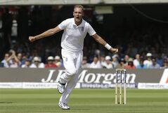 England's Stuart Broad celebrates the wicket of India's MS Dhoni during the first day of the second test match between England and India at Lord's cricket ground in London, Thursday, July 17, 2014. (AP Photo/Kirsty Wigglesworth)