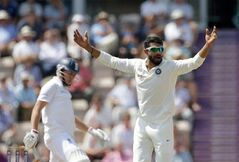 India's Ravindra Jadeja successfully appeals for the wicket of England's Gary Ballance, left, during the fourth day of the third cricket Test match of the series between England and India at The Ageas Bowl in Southampton, England, Wednesday, July 30, 2014. (AP Photo/Matt Dunham)