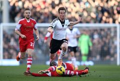 Fulham's Scott Parker, center, and Southampton's Victor Wanyama, below, battle for possession of the ball during their English Premier League soccer match at Craven Cottage, London, Saturday, Feb. 1, 2014. (AP Photo/John Walton, PA Wire) UNITED KINGDOM OUT - NO SALES - NO ARCHIVES