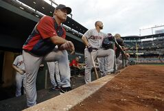 Boston Red Sox manager John Farrell, left, watches from the dugout in the third inning of a baseball game against the Baltimore Orioles, Monday, June 9, 2014, in Baltimore. (AP Photo/Patrick Semansky)