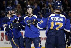 St. Louis Blues' Kevin Shattenkirk, center, is congratulated by teammates Matt D'Agostini, left, and Vladimir Sobotka, of the Czech Republic, after scoring during the second period of an NHL hockey game against the Edmonton Oilers, Friday, March 1, 2013, in St. Louis. (AP Photo/Jeff Roberson)