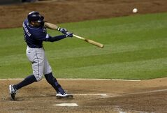 Tampa Bay Rays' Evan Longoria hits a sacrifice fly to score Desmond Jennings during the seventh inning of a baseball game against the St. Louis Cardinals, Wednesday, July 23, 2014, in St. Louis. (AP Photo/Jeff Roberson)