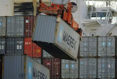 In this Monday, Jan. 27, 2014, photo, a ship to shore crane unloads a shipping container at the Georgia Ports Authority Garden City terminal, in Savannah, Ga. The Commerce Department releases wholesale trade inventories for December on Tuesday, Feb. 11, 2014. (AP Photo/Stephen B. Morton)