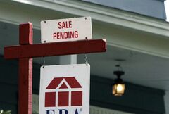 In this May 8, 2014 photo, a sign announces a residential home sale pending in Framingham, Mass. Freddie Mac reports on average U.S. mortgage rates for this week on Thursday, July 10, 2014. (AP Photo/Bill Sikes)