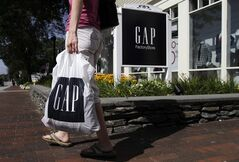 FILE - In this Wednesday, Aug. 17, 2011, file photo, a shopper leaves the Gap store in Freeport, Maine. Gap Inc. reports quarterly earnings on Thursday, May 22, 2014. (AP Photo/Pat Wellenbach, File)