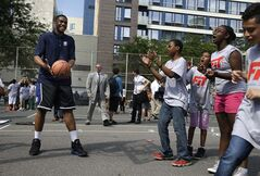 Duke's Jabari Parker, left, helps run drills during a basketball clinic in New York, Wednesday, June 25, 2014. Parker and other 2014 draft prospects are in town for the NBA draft in Brooklyn, New York on June 26, 2014. (AP Photo/Seth Wenig)