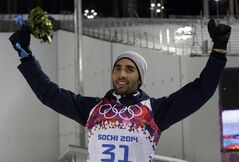 France's Martin Fourcade celebrates after winning the gold medal in the men's biathlon 20k individual race, at the 2014 Winter Olympics, Thursday, Feb. 13, 2014, in Krasnaya Polyana, Russia. (AP Photo/Lee Jin-man)
