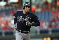 Atlanta Braves' Freddie Freeman rounds the bases after hitting a three-run home run in the first inning of a baseball game against the Philadelphia Phillies, Friday, June 27, 2014, in Philadelphia. (AP Photo/Laurence Kesterson)