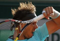 Spain's Rafael Nadal returns the ball to compatriot David Ferrer during their quarterfinal match of the French Open tennis tournament at the Roland Garros stadium, in Paris, France, Wednesday, June 4, 2014. (AP Photo/Michel Euler)