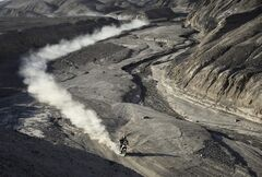 KTM rider Marc Coma of Spain rides his motorcycle during the ninth stage of the Dakar Rally between the cities of Calama and Iquique, Chile, Tuesday, Jan. 14, 2014. (AP Photo/Franck Fife, Pool)