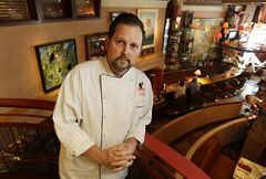 Nick Musser, general manager and executive chef of the icon Grill in Seattle, poses for a photo, Monday, June 2, 2014, in the dining area of his restaurant. Musser is worried that aspects of the $15 minimum wage passed Monday by the Seattle City Council will make it difficult for his independent restaurant to compete with larger companies that also operate restaurants. (AP Photo/Ted S. Warren)