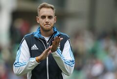 England's Stuart Broad takes part in a warm up prior to playing against India on the first day of the fifth test cricket match at Oval cricket ground in London, Friday, Aug. 15, 2014. Broad had his nose broken during that last test against India while batting. (AP Photo/Alastair Grant)