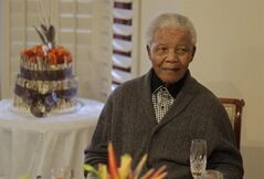 FILE - In this Wednesday, July 18, 2012 file photo, former South African President Nelson Mandela as he celebrates his 94th birthday with family in Qunu, South Africa. A South African official says Mandela is breathing