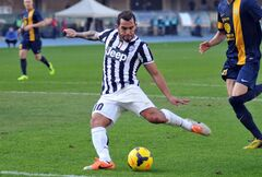 Juventus' forward Carlos Tevez, of Argentina scores during a Serie A soccer match against Hellas Verona at the Bentegodi stadium in Verona, Italy, Sunday, Feb. 9, 2014. (AP Photo/Felice Calabro')