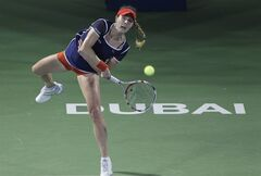Alize Cornet of France serves the ball to Serena Williams of the U.S. during a semi final match of Dubai Duty Free Tennis Championships in Dubai, United Arab Emirates, Friday, Feb. 21, 2014. (AP Photo/Kamran Jebreili)