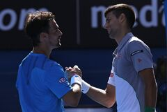Novak Djokovic of Serbia, right, shakes hands with Fabio Fognini of Italy after Djokovic won their fourth round match at the Australian Open tennis championship in Melbourne, Australia, Sunday, Jan. 19, 2014.(AP Photo/Eugene Hoshiko)
