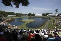 Golfers play the 17th hole during the second round of The Players championship golf tournament at TPC Sawgrass, Friday, May 9, 2014, in Ponte Vedra Beach, Fla. (AP Photo/John Raoux)
