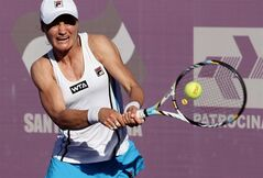 In this photo released by Fotoarena, Romanian Monica Niculescu returns a ball against Kristina Mladenovic of France during the WTA Brasil Tennis Cup semifinals in Florianopolis, Brazil, Friday, March 1, 2013. (AP Photo/Foto Arena, Cristiano Andujar)