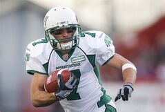Saskatchewan Roughriders' Weston Dressler, runs the ball against the Calgary Stampeders during first half CFL football action in Calgary, Alta., Saturday, Oct. 26, 2013. The Grey Cup-champion Roughriders released all-star slotback Dressler on Thursday.THE CANADIAN PRESS/Jeff McIntosh