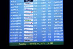 Cancelled flights are listed in Atlanta Feb. 11, 2014. THE CANADIAN PRESS/AP, David Tulis